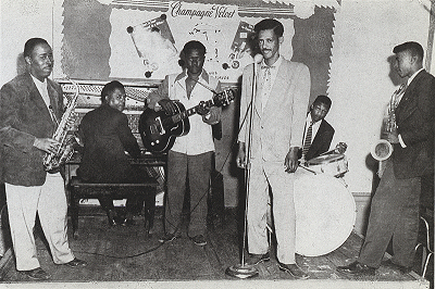 Willie Nix and his band ('Satchel Paige', saxophone; Jerry McConkle, guitar [seated at piano]; Joe Willie Wilkins, guitar; Willie Nix, drums / vocals; unidentified musician seated at drums; Adolph 'Billy' Duncan, saxophone); source: Postcard from postcard book by Stephen C. LaVere (Pomegranate Artbooks 1989, revised 1993); 'photograph courtesy Patty Nix'; click to enlarge!